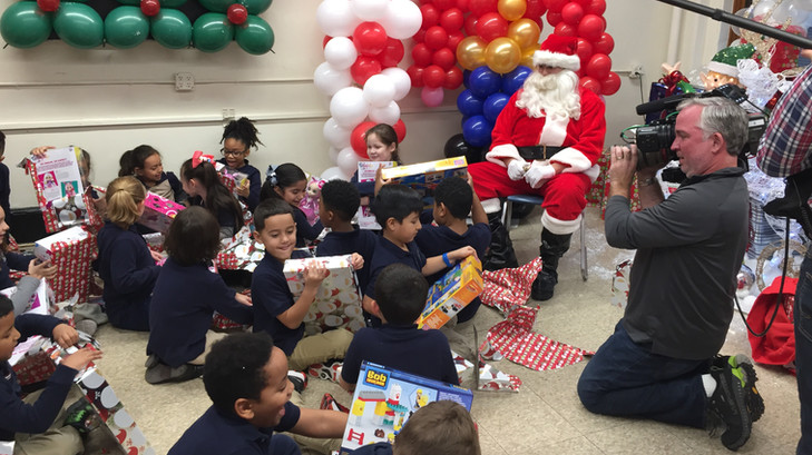 A student Santa shares gifts with students.