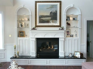 mantel, raised hearth, book cases