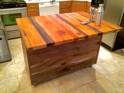 Rolling Walnut kitchen island with reclaimed butcher bloc top
