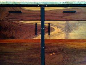 walnut and steel cabinet with handmade door pulls