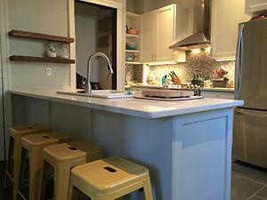 kitchen penninsula shaker-style doors floating shelves