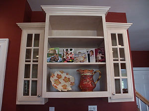 maple wall cabinet with glass doors and open shelves