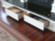 Hidden drawers in raised hearth