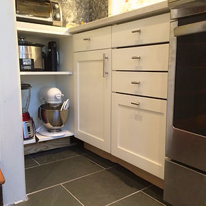 Shaker-style doors and drawers open shelves