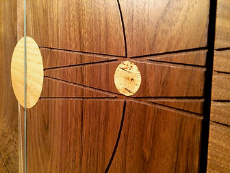 Cork, oak, and steel inlays on the Eclipse Credenza