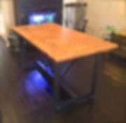 Reclaimed wood table with steel legs