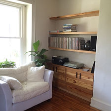 reclaimed wood floating shelves and cabinet