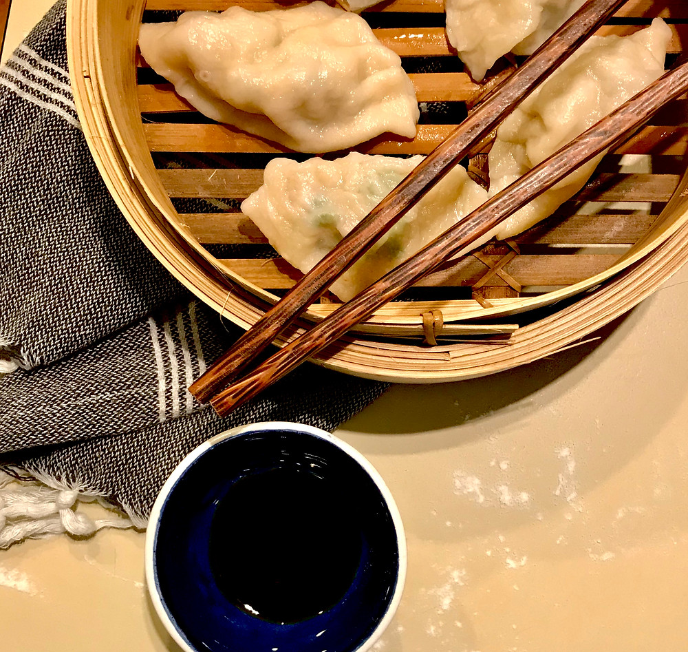 Pork dumplings in a bamboo steaming basket