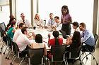 Businesswoman-speaking-to-others-around-