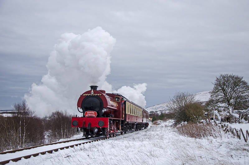 Steam locomotive 71515 hauling a Steam Santa Special service in the snow
