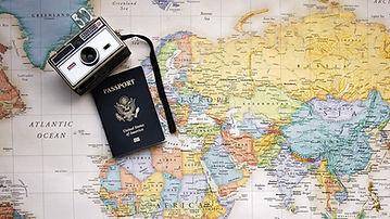 Passport, camera and world map