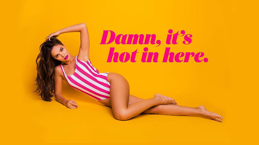 Yellow background brunette girl in pink and white swimsuit laying down new showgirls brisbane website edited damn it's hot in here.jpg