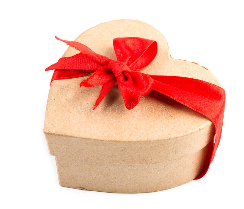 A box looks like a heart  with a red bow around it
