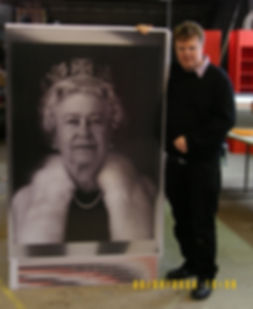 Artist Jeff Robb with a large scale lenticular poster of the Queen