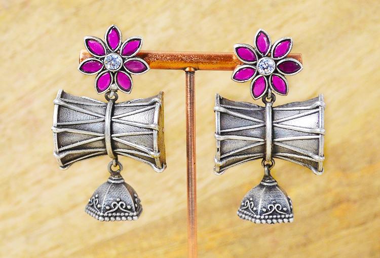 NAAD: Stone studded silver alike finish flower and dumru jhumkas