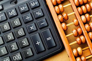 modern-calculator-and-abacus-MJ2T28Z.jpg