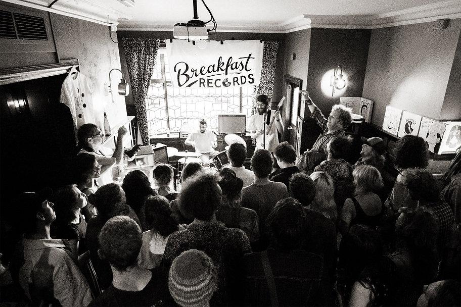 Jamie Cruickshank, musician, plays guitar on stage at The White Rabbit in DIY garage rock band Human Bones as Big Jeff sings along