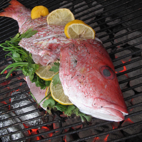 GRILLED WHOLE RED SNAPPER ON A BED OF ASPARAGUS