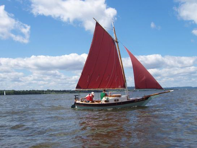 Sail boat with red sails