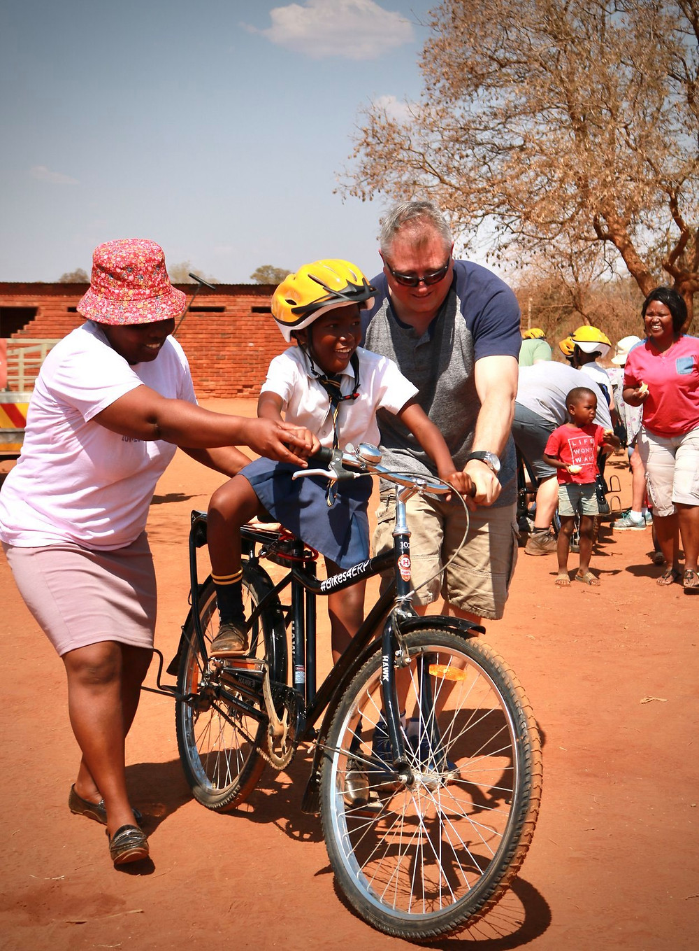 Helping young girls with her brand new bicycle