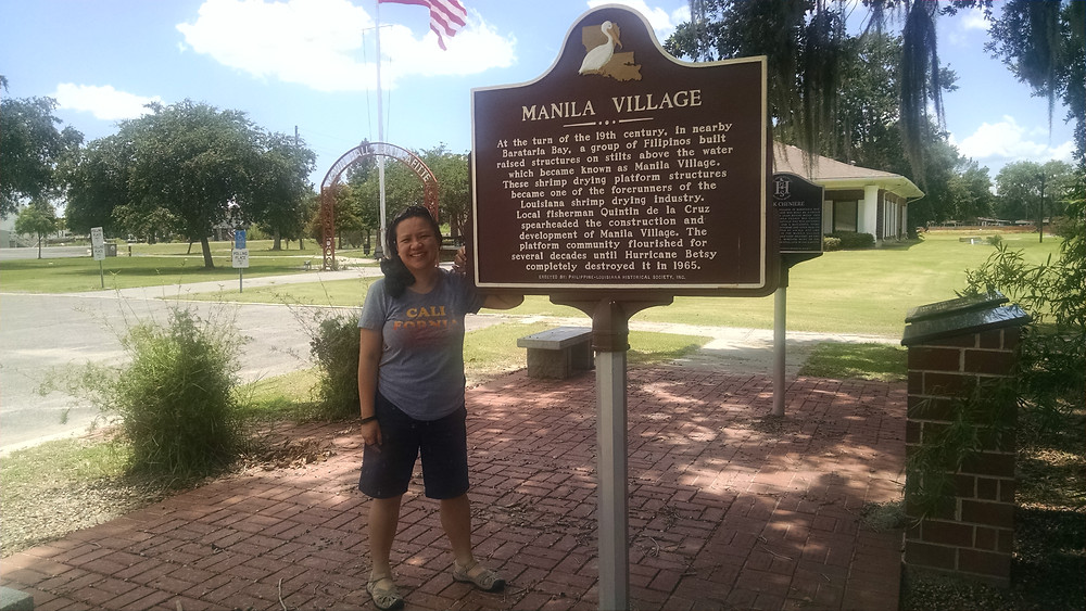 Photo of author by a historical marker in Manilla Village.