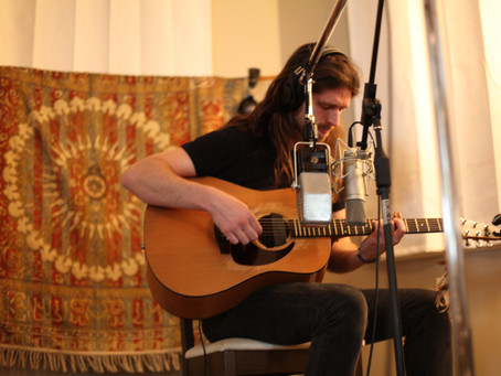 Tom. Guitars, Piano, and a Pulitzer-Prize Winner