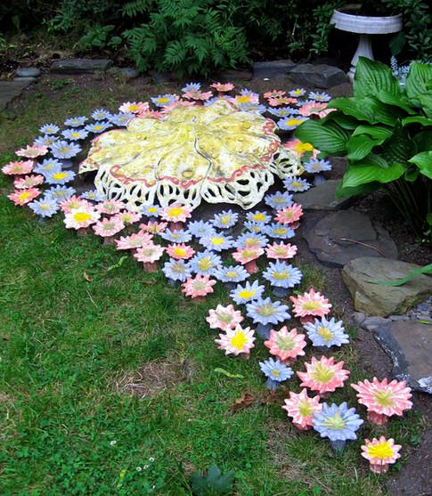 growning flowers & yellow mushroom top