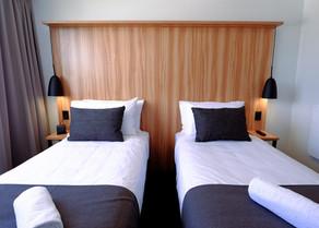 custom hotel bedheads and lighting