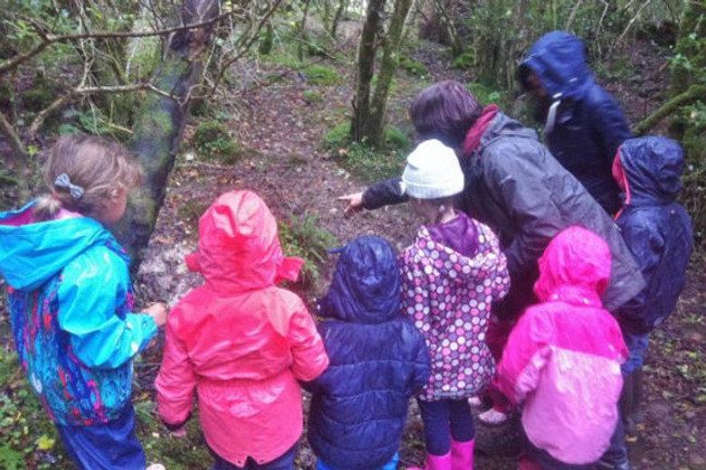 forest school raincoats pointing.jpeg