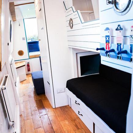 Modern bedroom inside a narrow boat