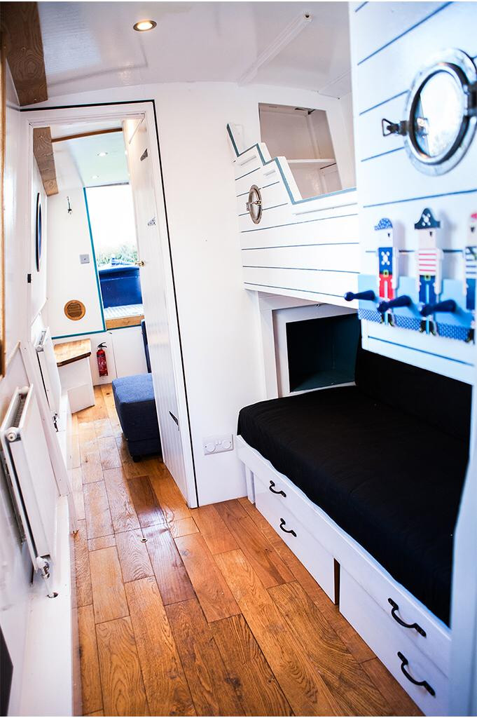 Modern bedroom inside a narrow boat