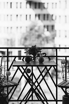 table and chairs on balcony in zurich