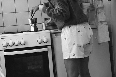 making coffee wearing boxers