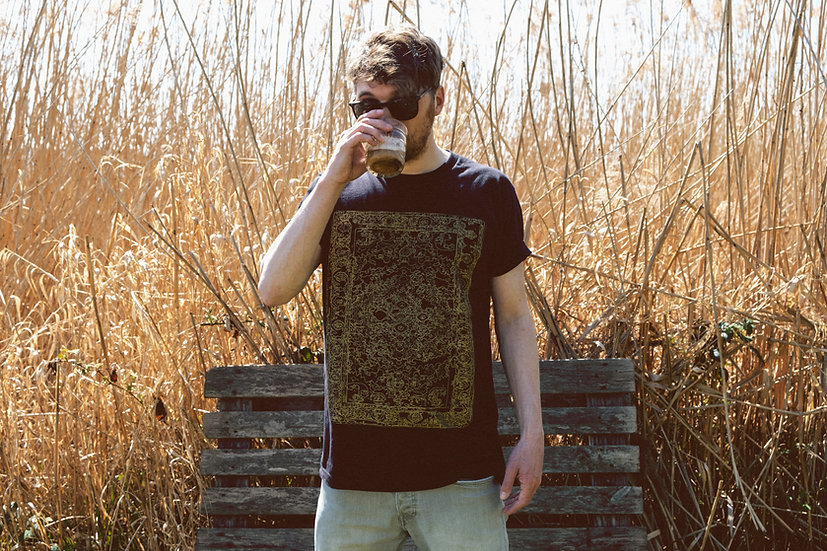 golden oriental rug t-shirt front view with reed in background while drinking coffee by l'n'l lnl-clothing.com