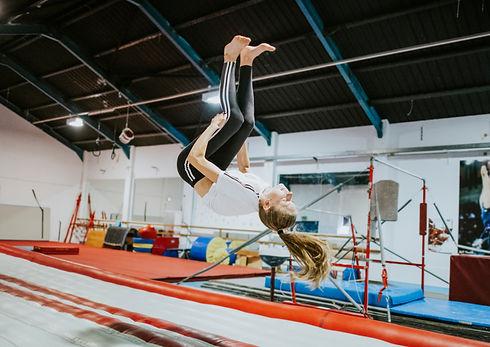 Female gymnast practicing a gymnastic.jp