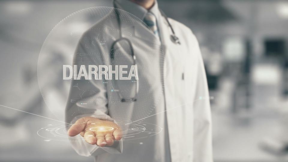 079086482-doctor-holding-hand-diarrhea