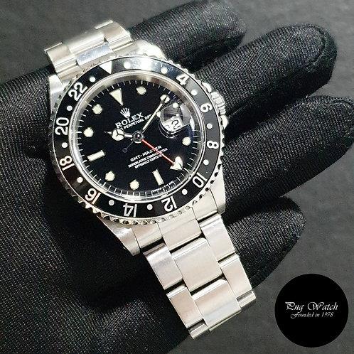 "Rolex Oyster Perpetual ""TRINOVA"" Black GMT Master REF: 16700 (U)(2)"