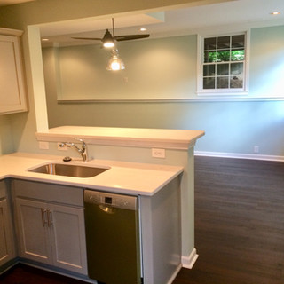 After, wall opening and basement kitchen