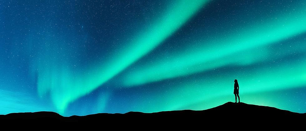 Woman-looking-skyward-aurora%20(1)_edited.jpg