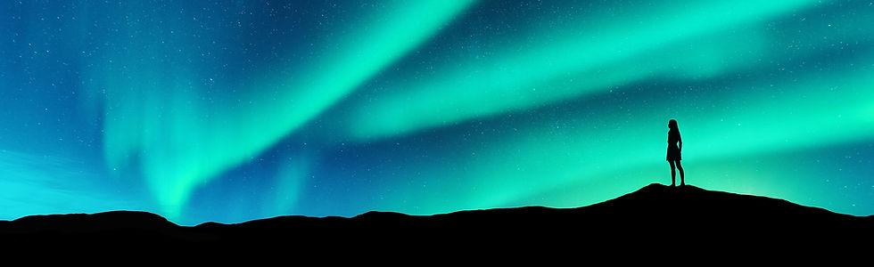 Woman-looking-skyward-aurora%20(1)_edite