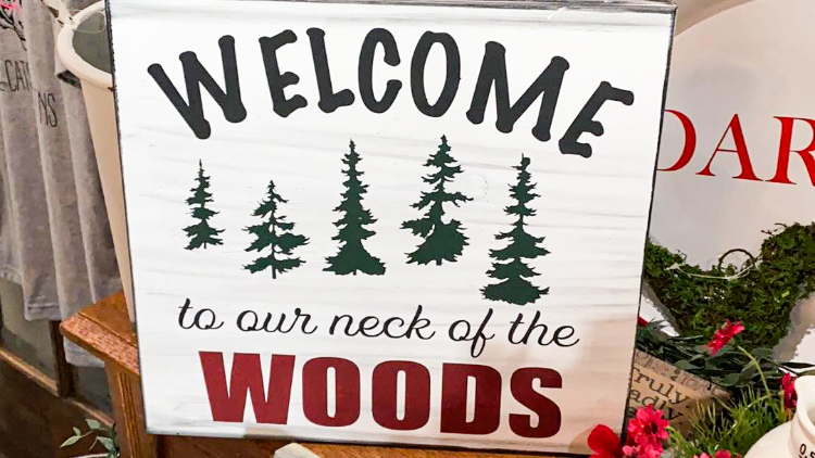 Welcome to our neck of the woods sign