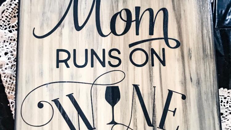 This Mom Runs On Wine Sign