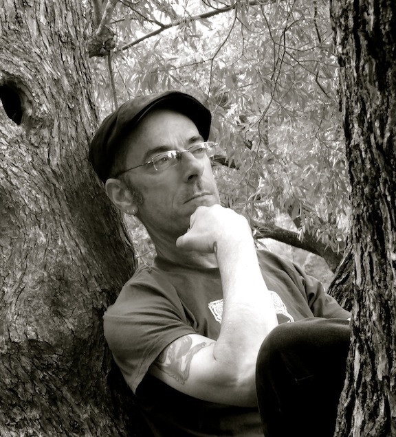 Yep, he climbed a tree for me just so I could snap a faux-contemplative shot :)