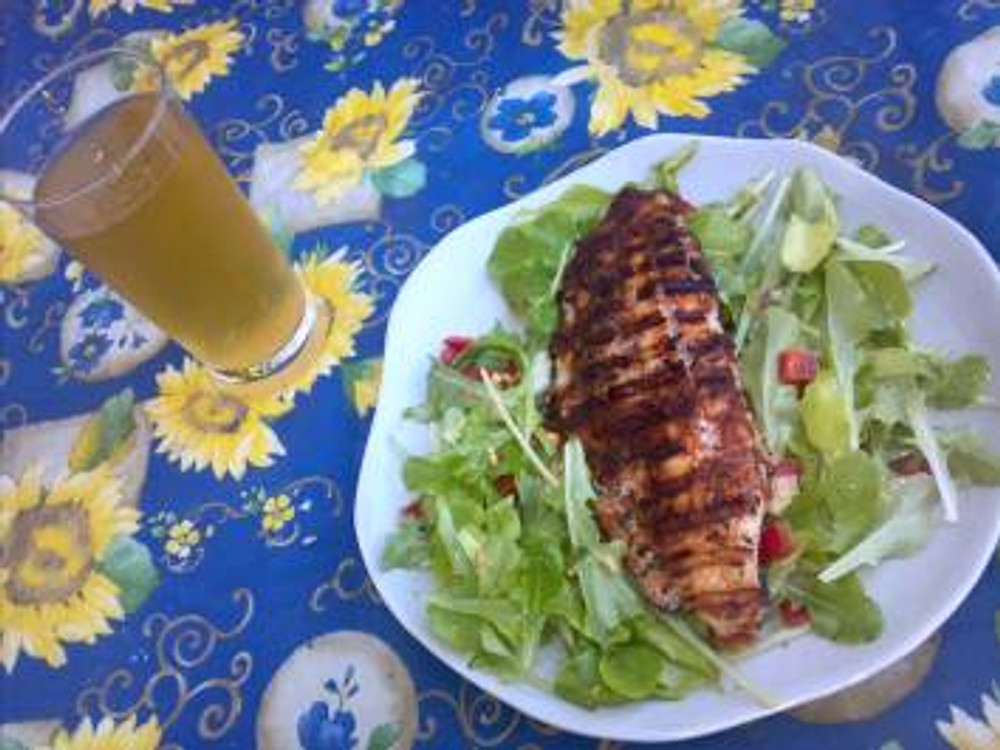 Grilled catfish in my homemade cajun seasoning, atop greens from my garden, washed down with a Reverend Nat's cider made right in my neighborhood
