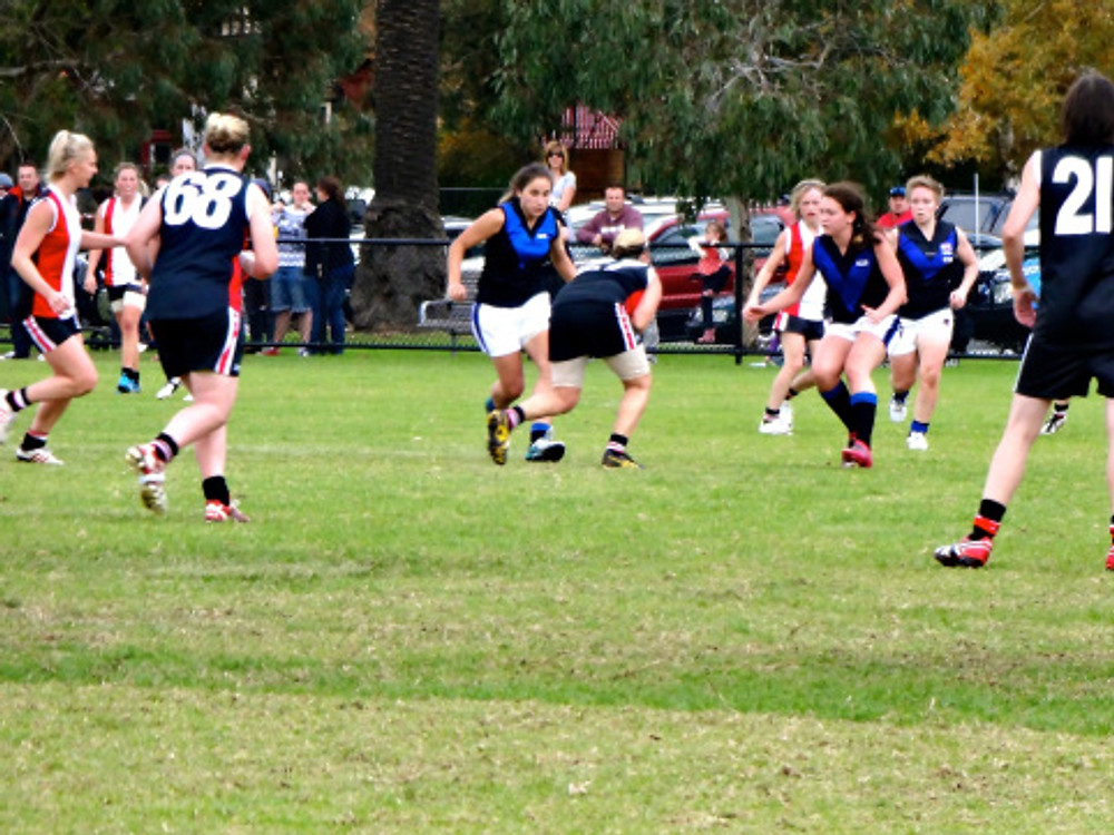 How awesome. Women's football in the park - gotta love it!