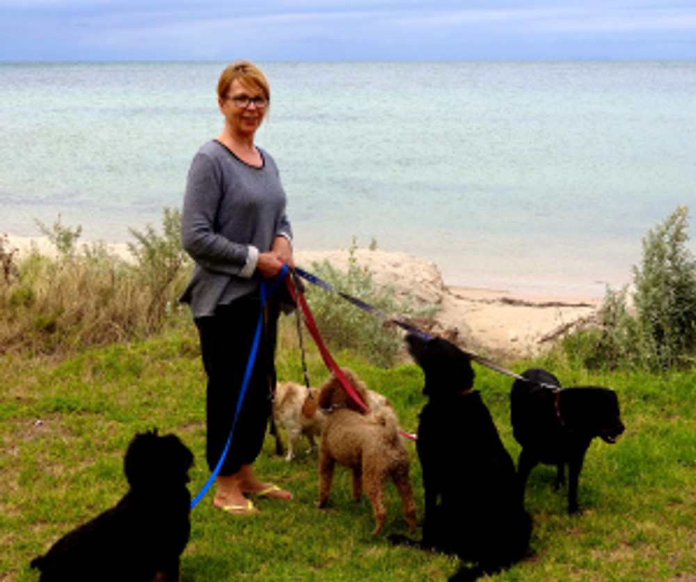 Kate & the crew (yes they have five dogs and yes, she's walked them all on her own before!)