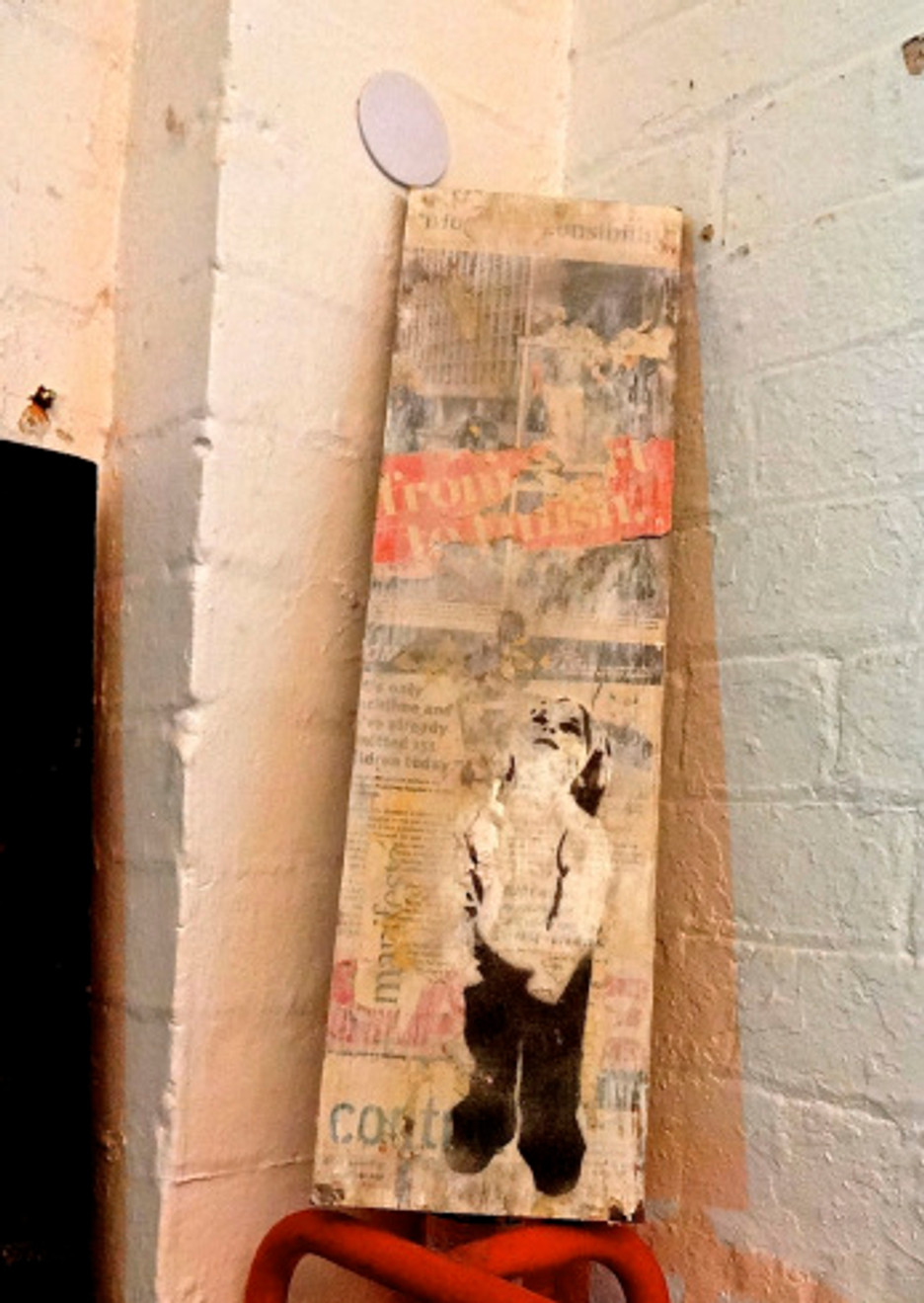 """Our original Mark Fitz piece from his show - """"Girl Looking Up"""" made on reclaimed wood with newspaper collage background. It is going to look fantastic here in our home in Portland!"""