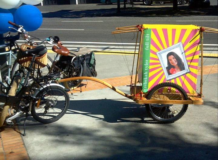 And on my way out, check out her bike trailer she and her hubby brought out here - does she fit in PDX well or what? :)