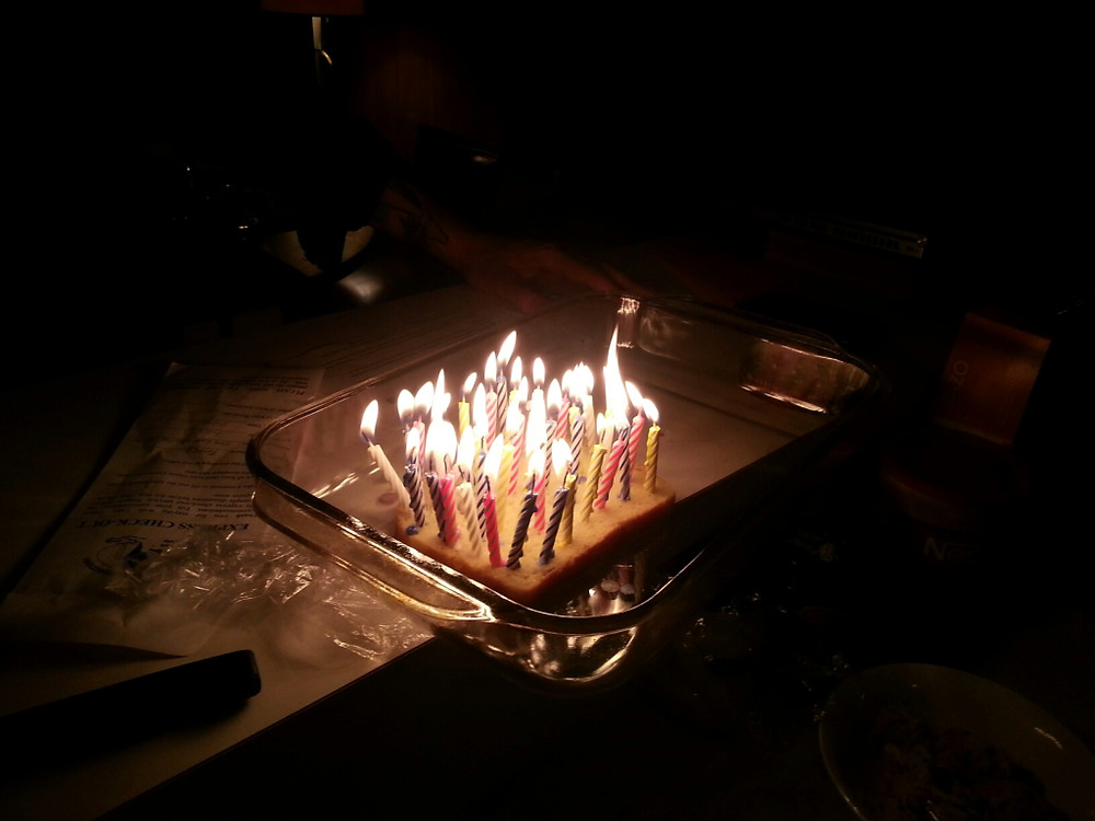 Pretty awesome seeing my friends, my sweetheart, and my brother & sister-in-law all grinning as my candles were brought to me to blow out.  If you chose DF ice cream for your b-day, how do you get 40 candles involved?  Simple! Bread!