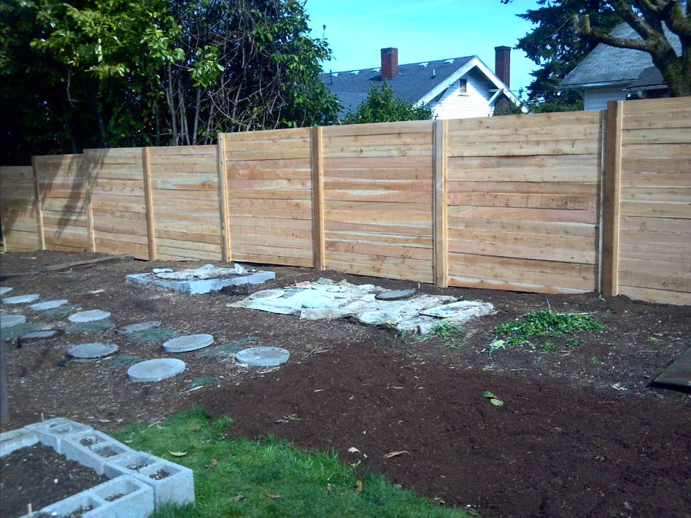 And as I finish, the fence is up and done! Pretty pretty!! It's cedar, so it will look even cooler when it weathers to that nice gray. SUCH a relief to have this project done so efficiently as well by the guys at Cascade Fence & Deck!